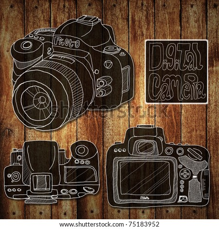 Digital camera drawing sketch on wood background