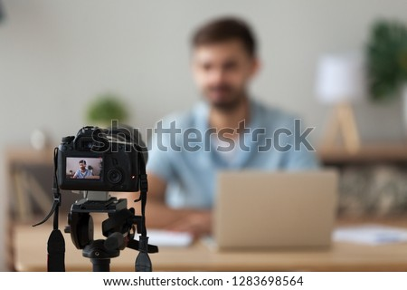 Digital camera filming commercial video blog or vlog of man teacher vlogger coach recording business course class or presentation training, device shooting videoblog  vlogging concept