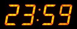 Digital clock show 23:59 on the black background