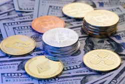 Digital coin cyberspace, cryptocurrency. Online payment. Rotating Bitcoin crypto currency with 100 dollar bills. Bitcoin BTC coin and Ethereum ETH, Litecoin LTC coins rotating on bills of 100 dollars.