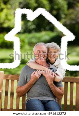 Digital composite image of senior couple sitting in the park with home outline