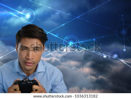 Stock Photo Digital composite of Businessman playing with computer game controller with sky connections background