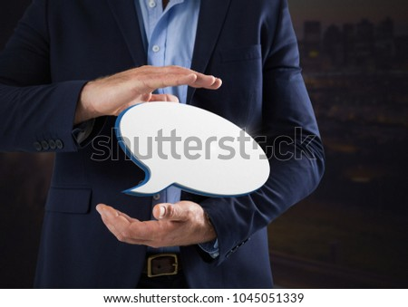 Digital composite of Chat bubble and Businessman with hands palm open and dark background #1045051339
