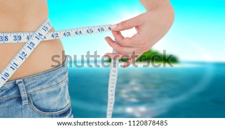 Digital composite of Composite image of midsection of woman measuring waist #1120878485