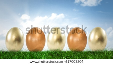 Digital composite of Easter eggs in front of blue sky #617003204
