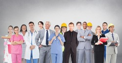 Digital composite of Group of people with different professions standing in front of blank grey background