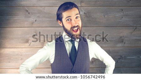 Digital composite of Happy hipster in formals against wooden wall #1056742496