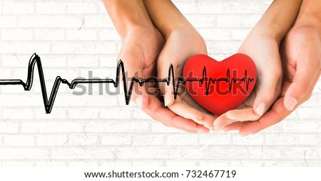 Digital composite of Heart beat over hands holding heart
