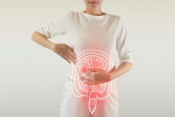 Digital composite of highlighted red painful intestine of woman / health care & medicine concept