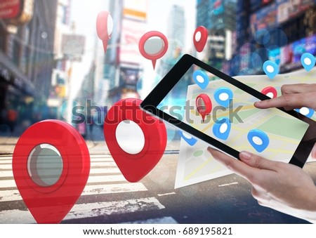 Digital composite of Holding tablet and City with  marker location pointers and map #689195821