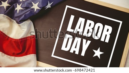 Digital composite of Labor day text over US flag #698472421