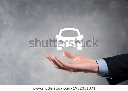 Digital composite of Man holding car icon.Car automobile insurance and car services concept. Businessman with offering gesture and icon of car.