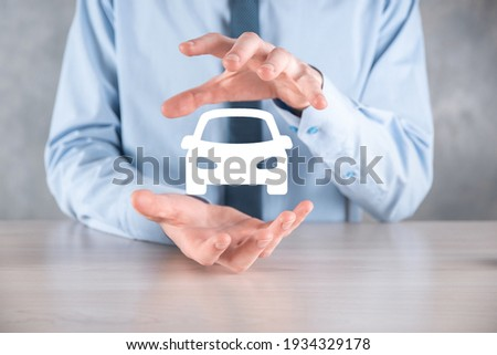 Digital composite of Man holding car icon.Car automobile insurance and car services concept. Businessman with offering gesture and icon of car Сток-фото ©
