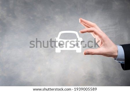 Digital composite of Man holding car icon.Car automobile insurance and car services concept. Businessman with offering gesture and icon of car. Сток-фото ©