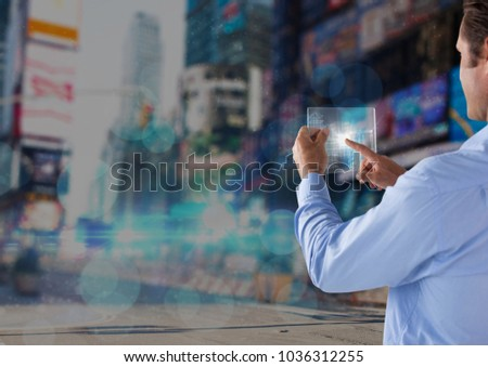 Digital composite of man holding glass interface #1036312255