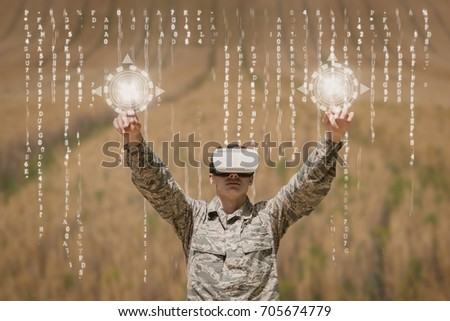 Digital composite of Military man in VR headset touching interfaces against field background with interfaces #705674779