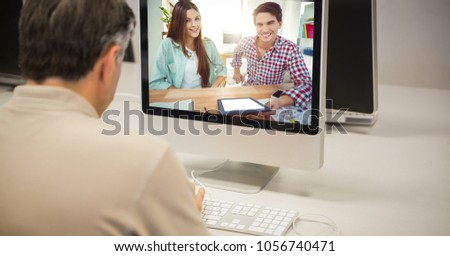 Digital composite of Rear view of businessman video conferencing on computer