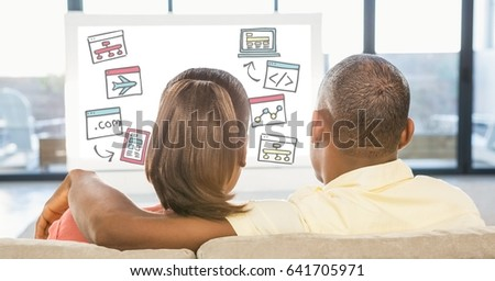 Digital composite of Rear view of couple looking at various icons on desktop pc while sitting at home