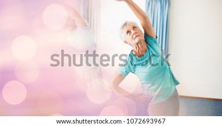 Digital composite of Senior woman exercising with bokeh in foreground