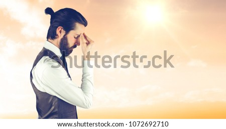Digital composite of Tensed male hipster in formals against sky #1072692710
