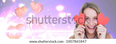 Digital composite of Valentines woman holding hearts with love hearts background #1007865847