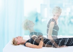 Digital composite of Woman Meditating astral projection out of body experience by window