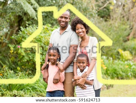 Digital composition of home outline with family standing in park