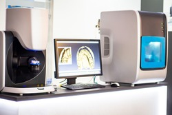 Digital dentistry. Digital scan in modern dentistry. Dental prosthesis on a computer scanner. The dental image is displayed on the computer screen. Concept analysis of prosthesis readiness