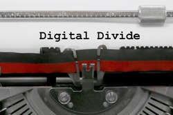 Digital divide text written by an old typewriter on white sheet
