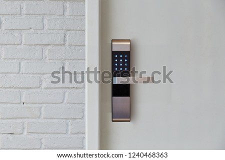Digital door lock security systems for access protection of hotel, apartment door. Electronic door handle with key pads numbers. Selective focus