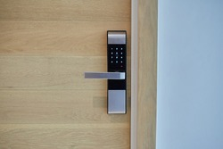 Digital door lock security systems for good safety of apartment door. Electronic door handle with key pads numbers. Selective focus