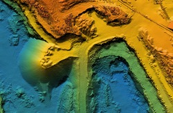 Digital elevation model  of a mine. GIS product made after proccesing aerial pictures taken from a drone by lidar laser scan. It shows map of an excavation site with steep rock walls