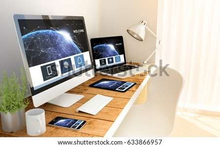 Digital generated devices over a wooden table with earth landing page responsive concept. All screen graphics are made up. some elements furnished by NASA. - Shutterstock ID 633866957