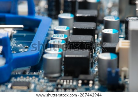 Digital hardware closeup. Microchips assembly on the circuit board macro