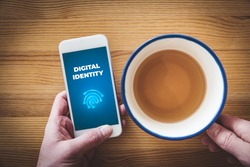 Digital identity and banking identity concept. Smart phone user with text digital identity and stylized fingerprint, symbol of unique identification and authentication, flat lay design.
