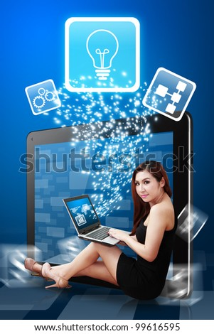Digital lady present Light Bulb icon from tablet pc