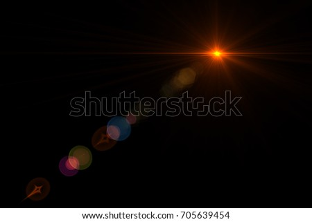 digital lens flare in black background.Beautiful rays of  glowing light. overlay texture banner effect in front or photo #705639454
