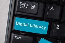 Digital Literacy write on keyboard isolated on laptop background