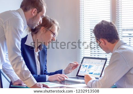 Digital marketing analyst people working on internet advertisement campaign analytics data on key performance indicator dashboard, metrics and KPI on computer screen, business strategy, investment #1232913508