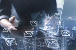 Digital marketing, Email campaign, newsletter, direct sales business strategy concept. Double exposure of business man sending email via smart phone, laptop computer and smart city with e-mail icons