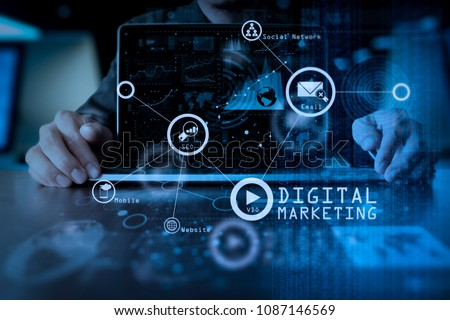 Digital marketing media (website ad, email, social network, SEO, video, mobile app) in virtual screen.business man hand working on laptop computer with digital layer business strategy .