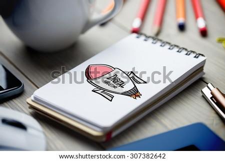 digital marketing rocket against notepad on desk
