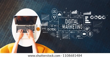 Digital Marketing with person using a laptop on a white table #1108681484