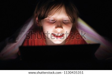 digital modern gadgets device addiction. gadget night sleeplessness. young caucasian girl browsing chatting playing serfing network with tablet bed. mobile phone apps. #1130435351