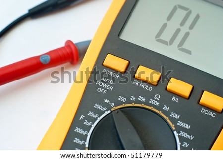 Digital multimeter closeup isolated on a white background