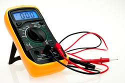 Digital multimeter with probes and blue backlit display on a white background