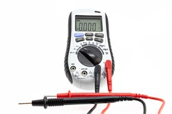digital multimeter with test probes, in the AC voltage reading position and the display on, marking a zero volt reading