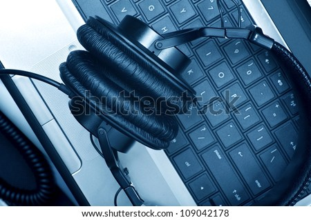Digital Music Composer Theme. Modern Laptop Computer and Large Professional Headphones. Digital Music Composer Workstation. Technology Photo Collection