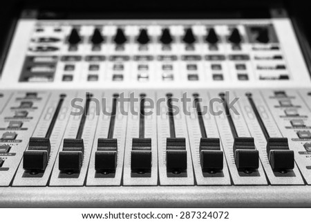 digital music studio recording mixer, shallow dept of field & focus to faders for recording or  TV / radio broadcast background