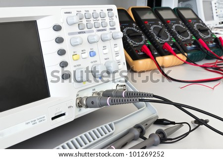 digital oscilloscope and measuring devices with cables ready for measurements in electrical laboratory #101269252